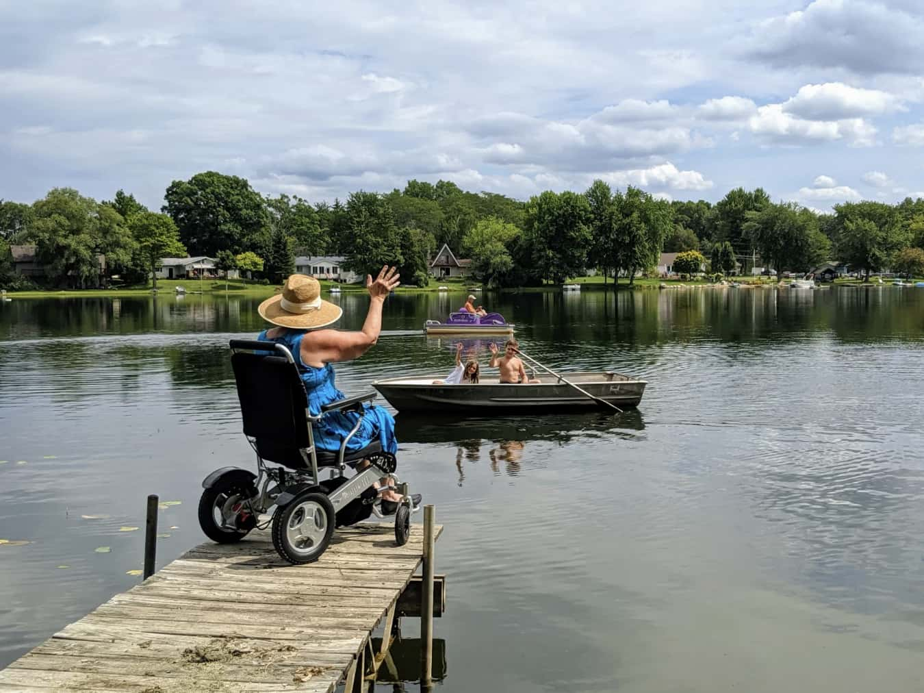 Woman in EagleHD Electric Wheelchair on jetty
