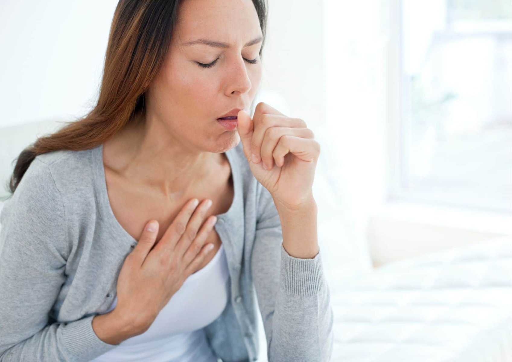 Woman coughing due to lung disease