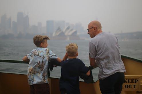 Father with kids in smokey Sydney