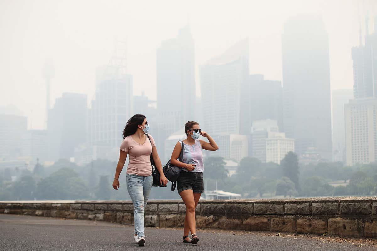 2 people walking in smoke city
