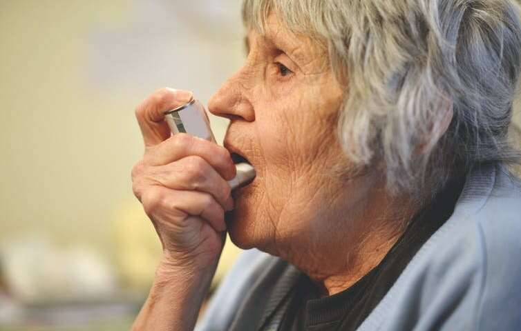 Elderly woman with inhaler