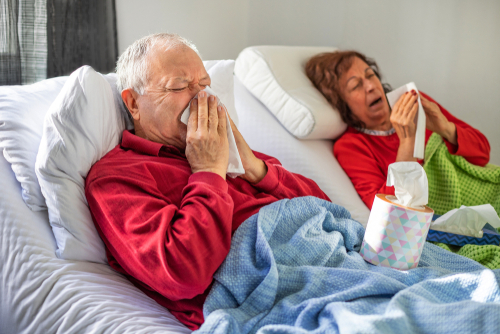 Couple in bed with flu