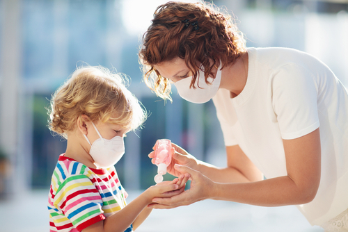 Woman and child with face mask